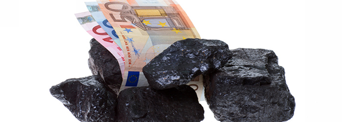 coal, carbon nuggets and euro banknote