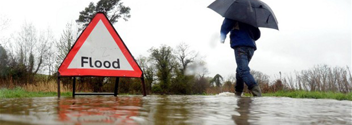 Dated:  26/04/2012    FLOODING IN THE NORTH   A man walks through a flooded road near Warkworth, Northumberland, as heavy rain continues to drench the UK ..  SEE STORY BY NORTH NEWS